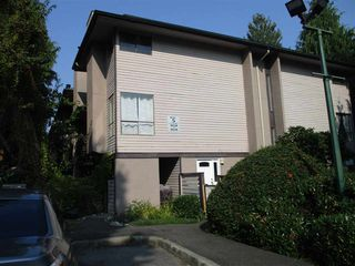 """Photo 1: 10550 HOLLY PARK Lane in Surrey: Guildford Townhouse for sale in """"Holly Park"""" (North Surrey)  : MLS®# R2498692"""