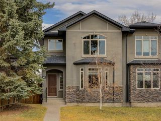 Photo 1: 40 ROSSDALE Road SW in Calgary: Rosscarrock Semi Detached for sale : MLS®# A1046518