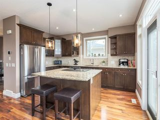 Photo 9: 40 ROSSDALE Road SW in Calgary: Rosscarrock Semi Detached for sale : MLS®# A1046518