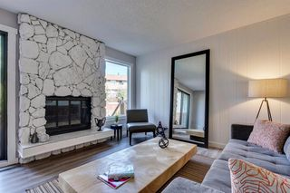 Photo 8: 123 WOODVALE Bay SW in Calgary: Woodlands Row/Townhouse for sale : MLS®# A1032069