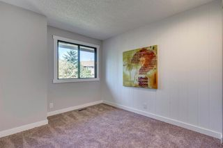 Photo 33: 123 WOODVALE Bay SW in Calgary: Woodlands Row/Townhouse for sale : MLS®# A1032069
