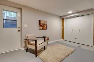 Photo 34: 123 WOODVALE Bay SW in Calgary: Woodlands Row/Townhouse for sale : MLS®# A1032069