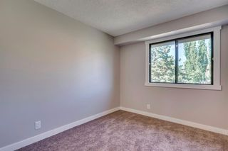 Photo 32: 123 WOODVALE Bay SW in Calgary: Woodlands Row/Townhouse for sale : MLS®# A1032069