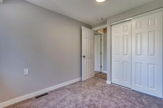 Photo 31: 123 WOODVALE Bay SW in Calgary: Woodlands Row/Townhouse for sale : MLS®# A1032069