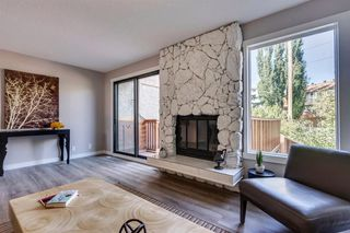 Photo 7: 123 WOODVALE Bay SW in Calgary: Woodlands Row/Townhouse for sale : MLS®# A1032069