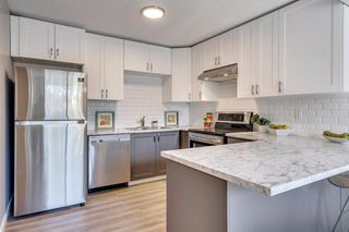 Photo 16: 123 WOODVALE Bay SW in Calgary: Woodlands Row/Townhouse for sale : MLS®# A1032069