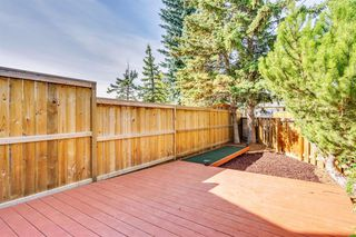 Photo 40: 123 WOODVALE Bay SW in Calgary: Woodlands Row/Townhouse for sale : MLS®# A1032069