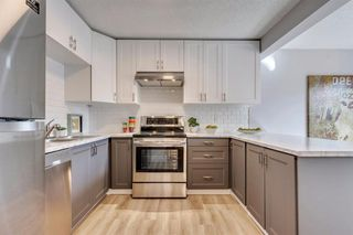 Photo 14: 123 WOODVALE Bay SW in Calgary: Woodlands Row/Townhouse for sale : MLS®# A1032069