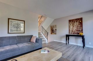 Photo 9: 123 WOODVALE Bay SW in Calgary: Woodlands Row/Townhouse for sale : MLS®# A1032069