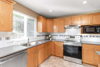 """Photo 14: 2983 ELBOW Place in Port Coquitlam: Riverwood House for sale in """"RIVERWOOD"""" : MLS®# R2506807"""