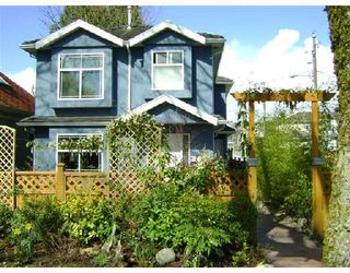 Photo 1: 1851 E 13TH Avenue in Vancouver: Grandview VE House 1/2 Duplex for sale (Vancouver East)  : MLS®# V700667