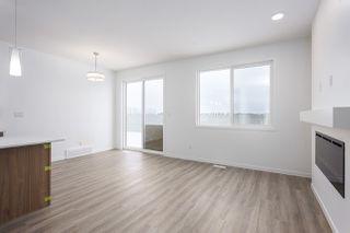 Photo 3: 693 EAGLESON Crescent in Edmonton: Zone 57 House Half Duplex for sale : MLS®# E4181644