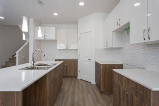Photo 2: 693 EAGLESON Crescent in Edmonton: Zone 57 House Half Duplex for sale : MLS®# E4181644
