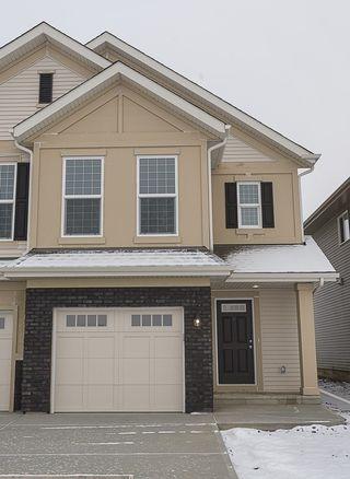 Photo 1: 693 EAGLESON Crescent in Edmonton: Zone 57 House Half Duplex for sale : MLS®# E4181644