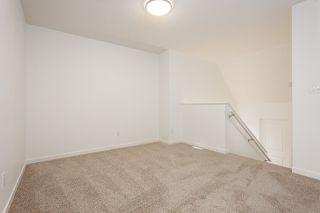 Photo 4: 693 EAGLESON Crescent in Edmonton: Zone 57 House Half Duplex for sale : MLS®# E4181644