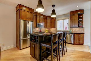Photo 4: 103 449 20 Avenue NE in Calgary: Winston Heights/Mountview Row/Townhouse for sale : MLS®# A1010445