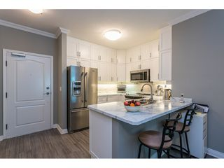 """Photo 4: 102 1685 152A Street in Surrey: King George Corridor Condo for sale in """"Suncliff Place"""" (South Surrey White Rock)  : MLS®# R2483408"""