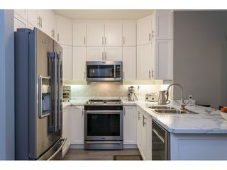 """Photo 5: 102 1685 152A Street in Surrey: King George Corridor Condo for sale in """"Suncliff Place"""" (South Surrey White Rock)  : MLS®# R2483408"""