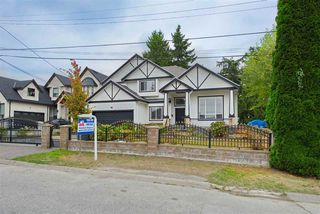 Photo 1: 8862 139 Street in Surrey: Bear Creek Green Timbers House for sale : MLS®# R2493060