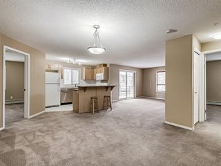 Photo 3: 3201 60 PANATELLA Street NW in Calgary: Panorama Hills Apartment for sale : MLS®# A1051876