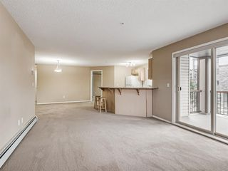 Photo 5: 3201 60 PANATELLA Street NW in Calgary: Panorama Hills Apartment for sale : MLS®# A1051876