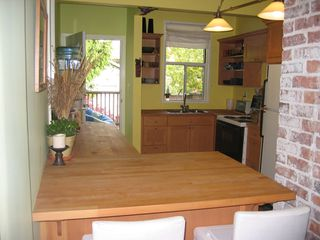 Photo 4: 1613 East 4th Avenue in Vancouver: Home for sale