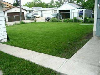 Photo 4: 616 STEWART Street in Winnipeg: Westwood / Crestview Single Family Detached for sale (West Winnipeg)  : MLS®# 2508856