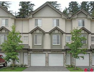 "Photo 1: 35 14855 100TH Avenue in Surrey: Guildford Townhouse for sale in ""HAMSTEAD MEWS"" (North Surrey)  : MLS®# F2720151"