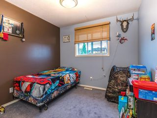 Photo 10: 15758 EVERSTONE Road SW in Calgary: Evergreen Detached for sale : MLS®# C4303466