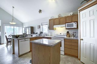 Photo 5: 16034 EVERSTONE Road SW in Calgary: Evergreen Detached for sale : MLS®# A1054411