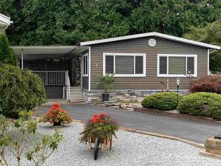 """Photo 1: 7 2315 198 Street in Langley: Brookswood Langley Manufactured Home for sale in """"Dear Creek Estates"""" : MLS®# R2414714"""