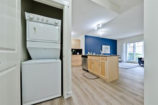 Photo 4: 1404 5605 HENWOOD Street SW in Calgary: Garrison Green Apartment for sale : MLS®# A1019353