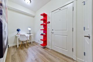Photo 2: 1404 5605 HENWOOD Street SW in Calgary: Garrison Green Apartment for sale : MLS®# A1019353