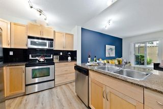 Photo 8: 1404 5605 HENWOOD Street SW in Calgary: Garrison Green Apartment for sale : MLS®# A1019353