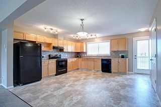 Photo 9: 1003 140 Sagewood Boulevard SW: Airdrie Row/Townhouse for sale : MLS®# A1040152