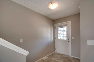 Photo 3: 1003 140 Sagewood Boulevard SW: Airdrie Row/Townhouse for sale : MLS®# A1040152