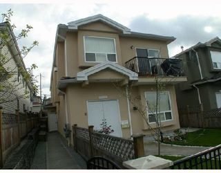 Photo 2: 4952 DOMINION Street in Burnaby: Central BN House 1/2 Duplex for sale (Burnaby North)  : MLS®# V702179