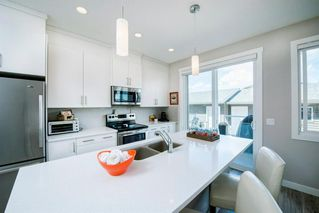 Photo 9: 25 HOWSE Street NE in Calgary: Livingston Semi Detached for sale : MLS®# A1028940