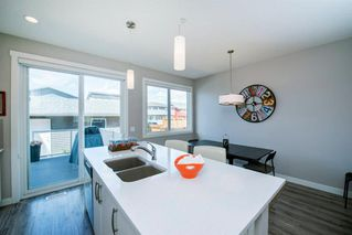Photo 8: 25 HOWSE Street NE in Calgary: Livingston Semi Detached for sale : MLS®# A1028940