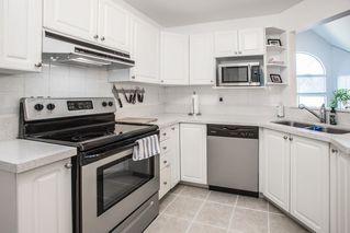 "Photo 10: 303 7161 121 Street in Surrey: West Newton Condo for sale in ""HIGHLANDS"" : MLS®# R2412471"