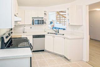 "Photo 9: 303 7161 121 Street in Surrey: West Newton Condo for sale in ""HIGHLANDS"" : MLS®# R2412471"
