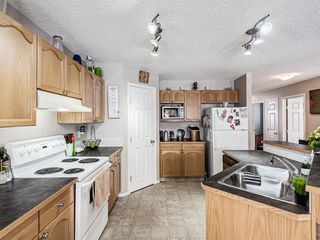 Photo 8: 306 Cimarron Boulevard: Okotoks Detached for sale : MLS®# A1050486