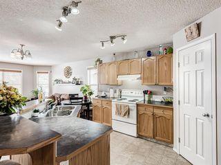 Photo 9: 306 Cimarron Boulevard: Okotoks Detached for sale : MLS®# A1050486