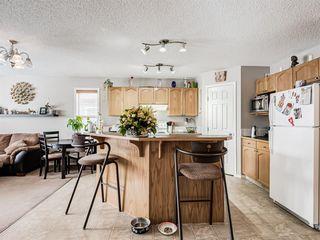 Photo 5: 306 Cimarron Boulevard: Okotoks Detached for sale : MLS®# A1050486