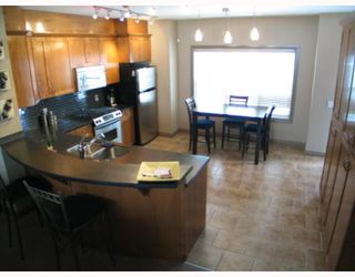 Photo 2: 147 Couture Crescent SW in CALGARY: Garrison Green Townhouse for sale (Calgary)  : MLS®# C3261879