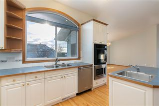 Photo 11: 124 Harrison Court: Crossfield Detached for sale : MLS®# C4285577