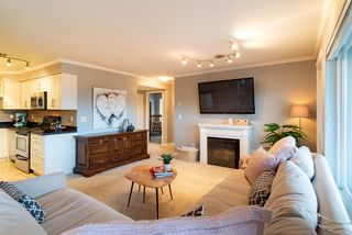 "Main Photo: 309 22255 122 Avenue in Maple Ridge: West Central Condo for sale in ""Magnolia Gate"" : MLS®# R2460012"