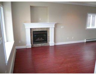 Photo 2: A 917 RODERICK Avenue in Coquitlam: Maillardville House 1/2 Duplex for sale : MLS®# V704855