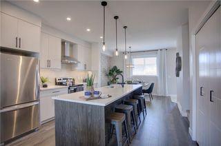 Photo 7: 39 D'Arcy Boulevard: Okotoks Row/Townhouse for sale : MLS®# A1048108