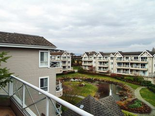 "Photo 10: 305 5556 201A Street in Langley: Langley City Condo for sale in ""MICHAUD GARDENS"" : MLS®# F2705422"